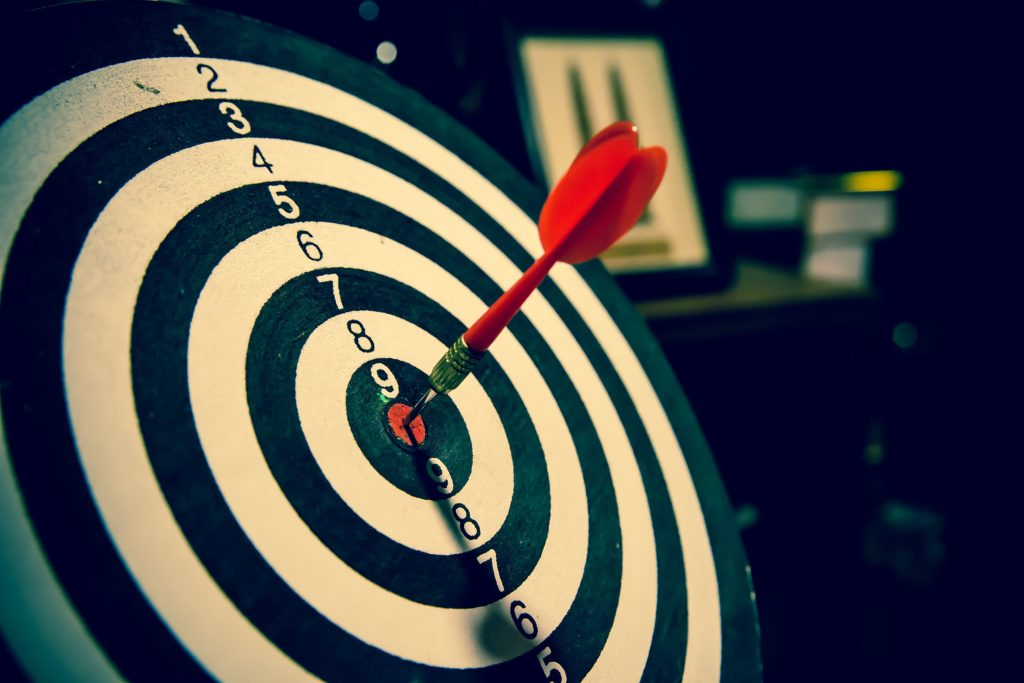 a red arrow in the middle of a bull's eye, hitting a target